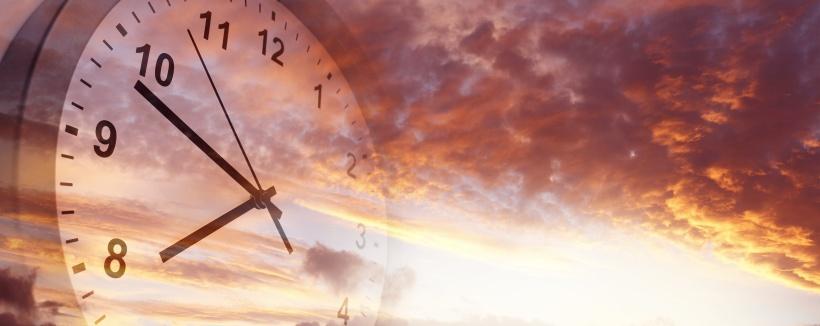 Looming clock floating in sky.jpeg